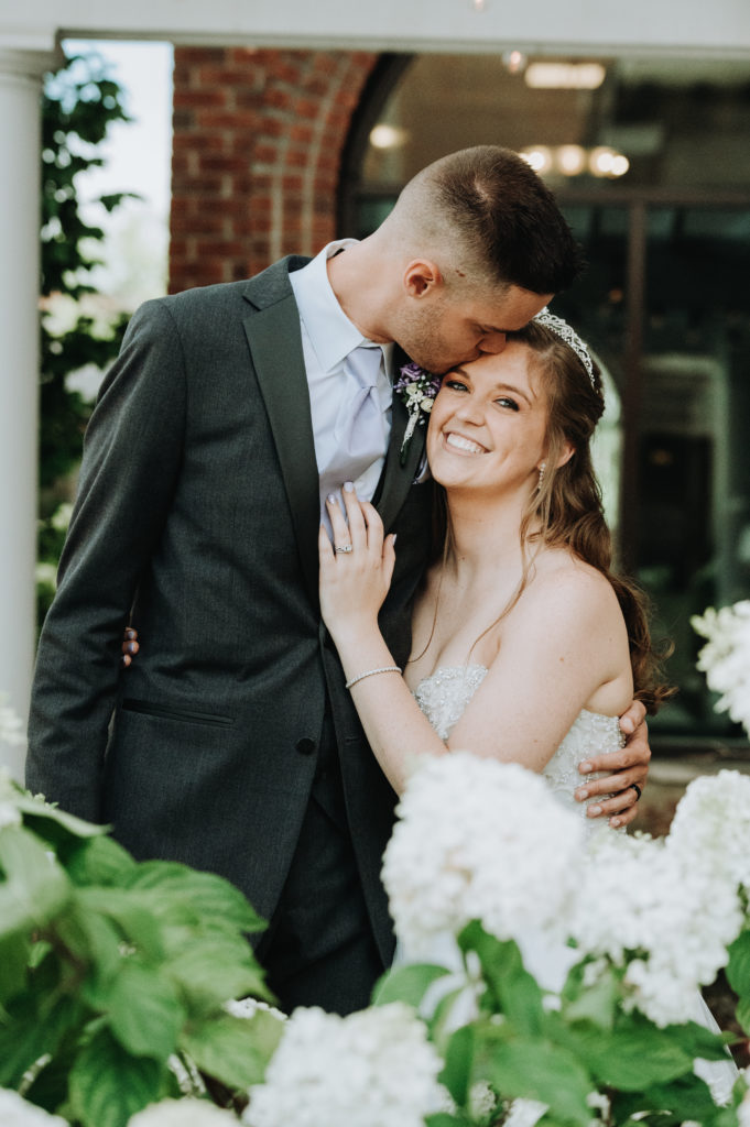 Groom Kisses Bride on the Forehead